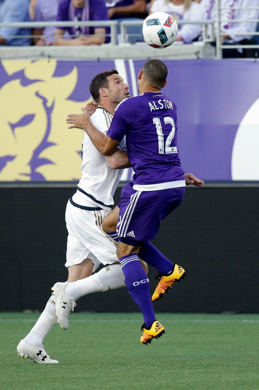 Philadelphia Union's Chris Pontius, left, and Orlando City 's Kevin Alston (12) collide going for the ball during the first half of an MLS soccer game, Wednesday, May 25, 2016, in Orlando, Fla. (AP Photo/John Raoux)