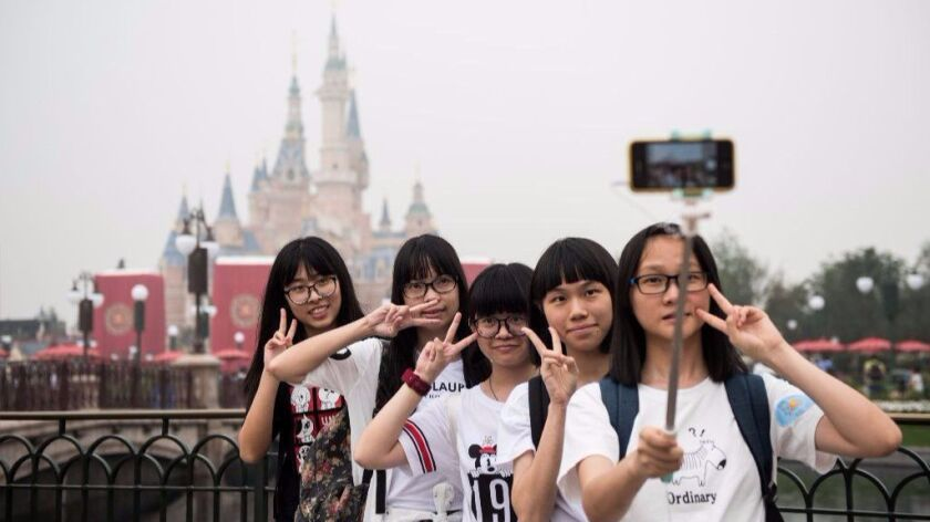 Visitors take a selfie after the opening ceremony of the Shanghai Disney Resort on June 16, 2016. A new digital version of Fastpass will launch in the fall.