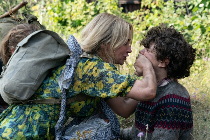 """Emily Blunt frantically covers Noah Jupe's mouth in the movie """"A Quiet Place Part II."""""""