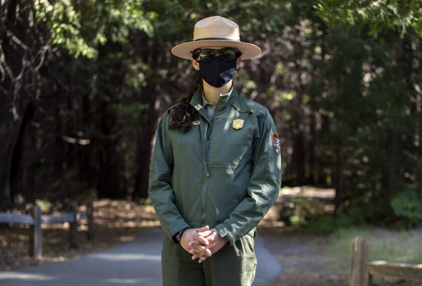 Park ranger Jamie Jirele wears a mask in Yosemite Valley.