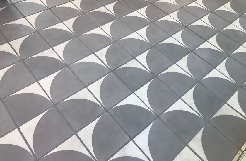 A geometric tile floor, inspired by the circular shape of the Mark Taper Forum, at Go Get Em Tiger.