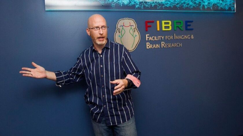 Craig Stark, designer of UC Irvine's FIBRE center and a professor of neurobiology and behavior, give