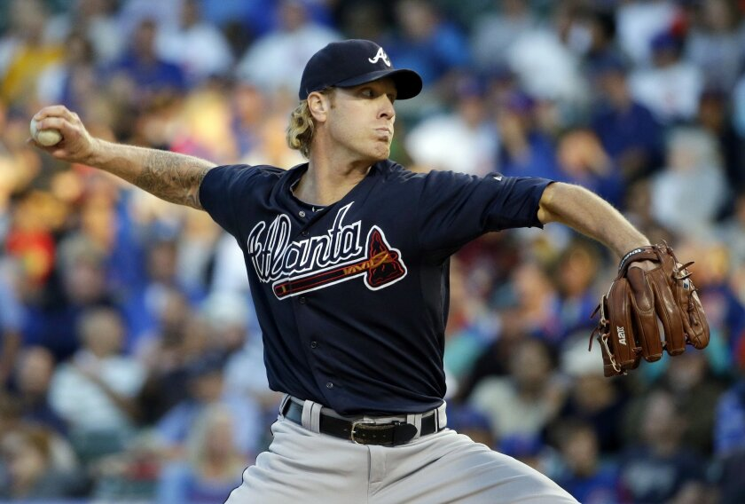 FILE - In this Thursday, Aug. 20, 2015, file photo, Atlanta Braves starter Mike Foltynewicz throws against the Chicago Cubs during the first inning of a baseball game, in Chicago. After life-threatening blood clots in his right shoulder ended his 2015 season, Braves right-handed pitcher Foltynewicz