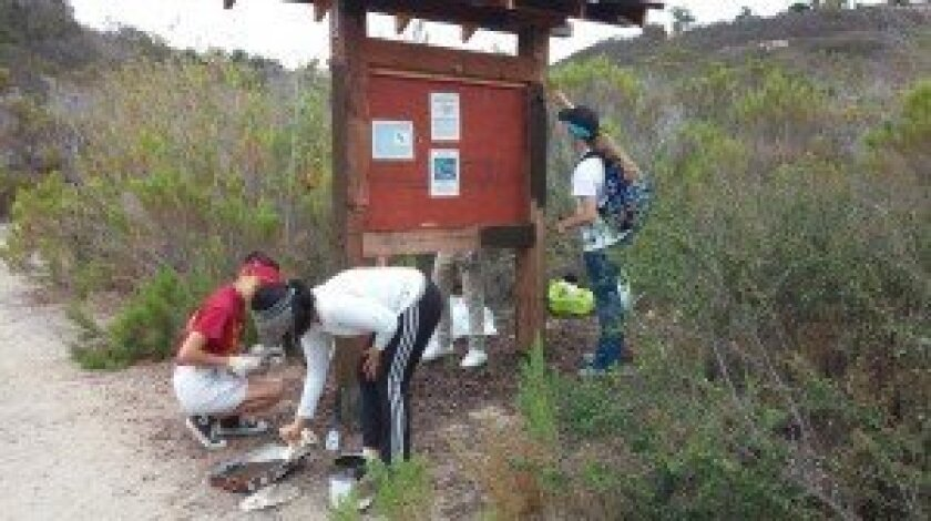 Friends of the Gonzales Canyon volunteers painted a new kiosk and picked up trash, thistles and tumbleweeds. Courtesy photos