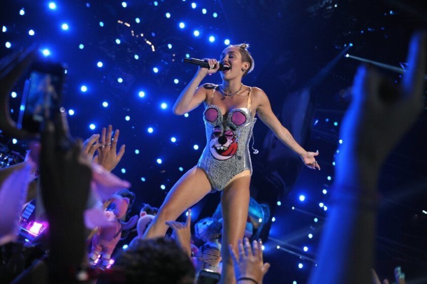 Miley Cyrus performs at the MTV Video Music Awards in her teddy bear bathing suit outfit.