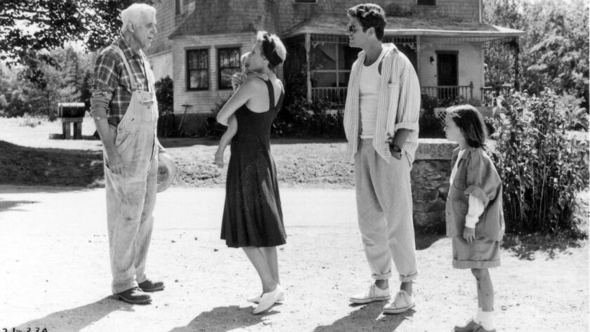 """From the movie """"Pet Sematary."""" Jud Crandall (Fred Gwynne, left) meets his new neighbors, Rachel and"""