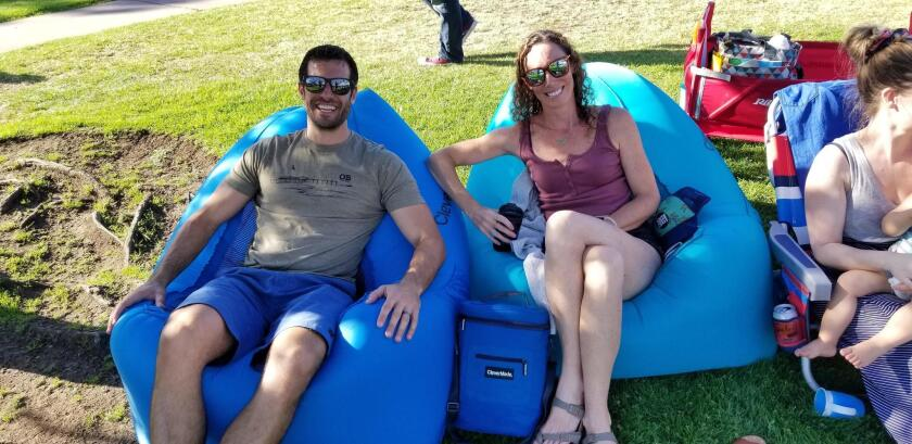 Scott Apone and Tiffany Schrade do comfy concert seating right by reclining in CleverMade AirChairs!