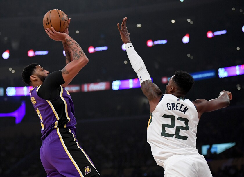 Lakers star Anthony Davis shoots a fadeaway jumper over Utah Jazz forward Jeff Green during the first half of Friday's game.