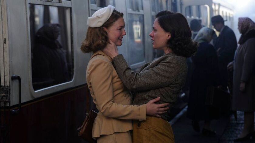 """Holliday Grainger, left, and Anna Paquin in a scene from """"Tell It to the Bees."""""""