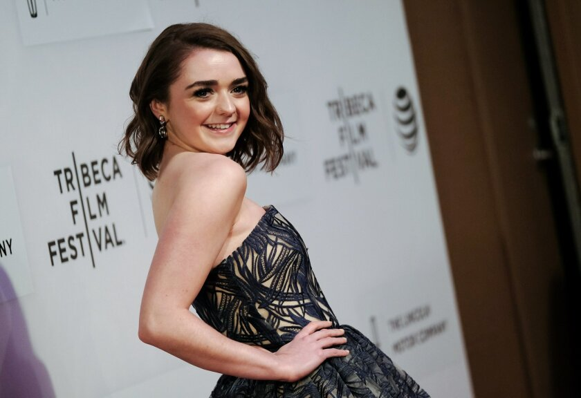 "In this April 14, 2016, file photo actress Maisie Williams attends the world premiere screening of ""The Devil and the Deep Blue Sea"" during the 2016 Tribeca Film Festival in New York. She will appear with the rest of the ""Game of Thrones"" cast at Comic-Con."