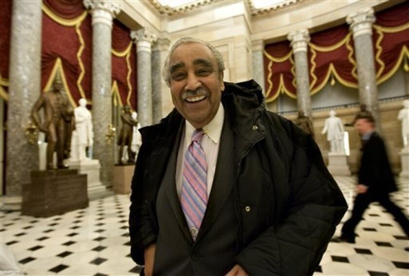 Rep. Charlie Rangel, D-N.Y., smiles as he leaves the House of Representatives where majority Democrats, in the face of strong GOP opposition, passed a $14 billion emergency loan for struggling U.S. automakers, at the Capitol in Washington, Wednesday, Dec. 10, 2008. (AP Photo/J. Scott Applewhite)