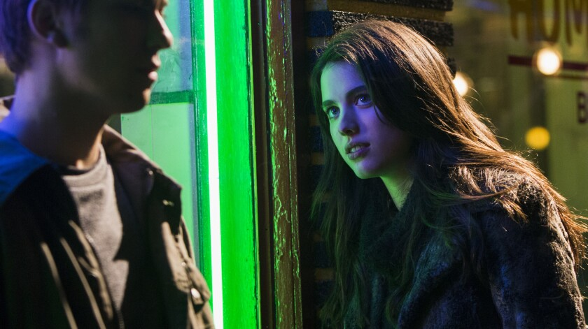 """The power of — love? Nat Wolff and Margaret Qualley in a scene from """"Death Note."""""""