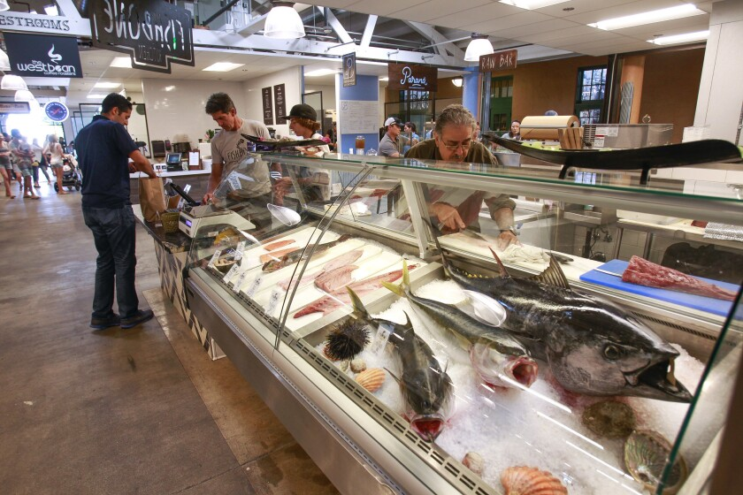 Fresh fish is on display at the Fishbone Kitchen counter at Liberty Public Market at Liberty Station.