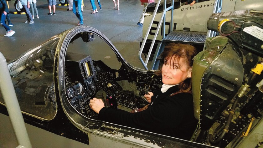 'Top Gun' Editor Susan DeMaggio (pictured aboard the USS Midway aircraft carrier) can be reached at (858) 875-5950 or e-mail: editor@lajollalight.com