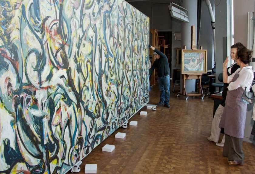 """Jackson Pollock's work """"Mural""""(1943) arrived at the Getty Center in Los Angeles in 2012, with conservators looking on."""