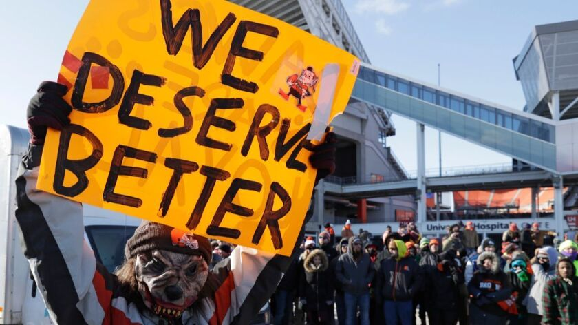 """A Cleveland Browns fan holds up a sign during the """"Perfect Season"""" parade, Saturday, Jan. 6, 2018, i"""
