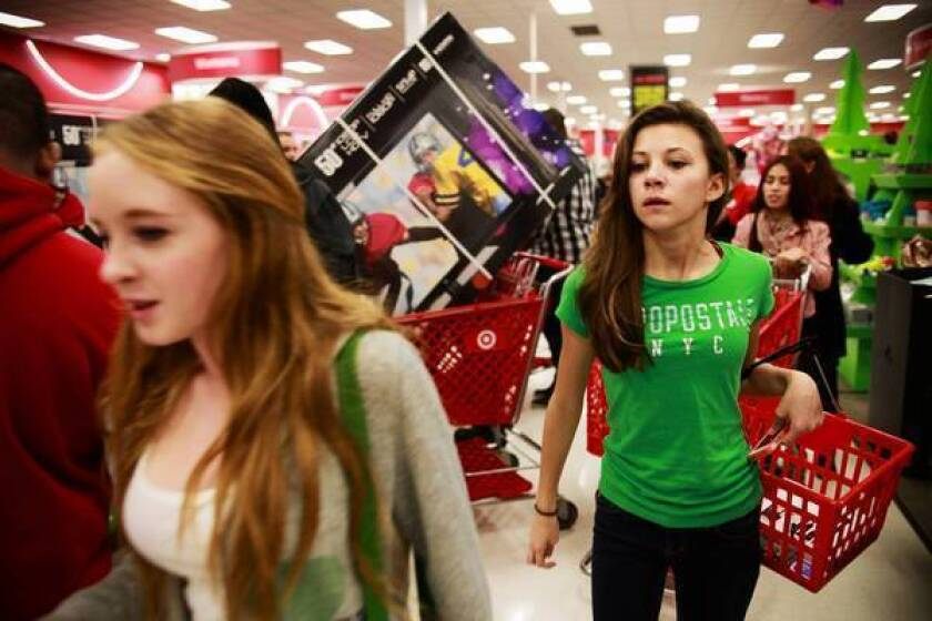 Early-bird shoppers search for deals at a Target in Burbank on Black Friday. Some people, on the other hand, still expect to be shopping for gifts on Christmas Eve.