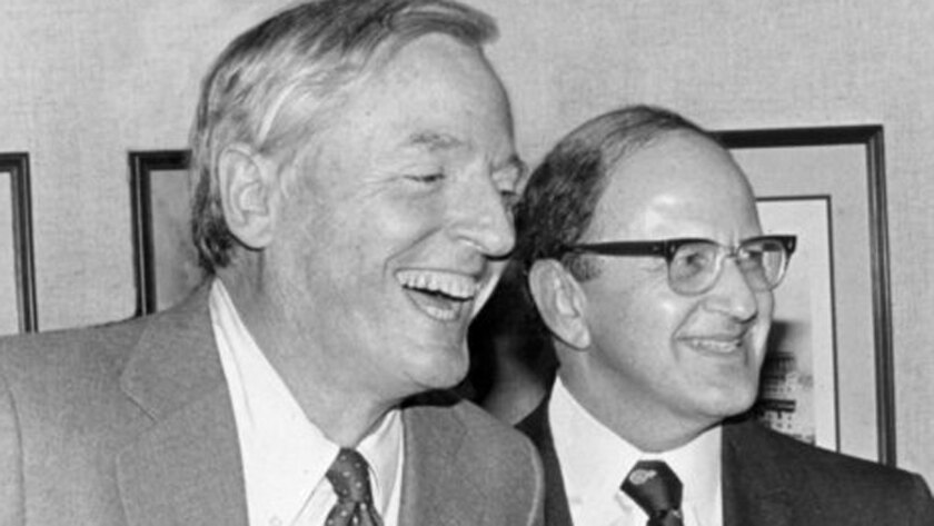 William F. Buckley, left, attends a dinner honoring his friend Harry Jaffa, right, in 1984.