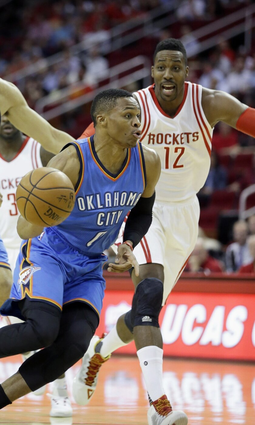 Houston Rockets' Dwight Howard (12) chases Oklahoma City Thunder's Russell Westbrook to the basket in the first half of an NBA basketball game Monday, Nov. 2, 2015, in Houston. (AP Photo/Pat Sullivan)