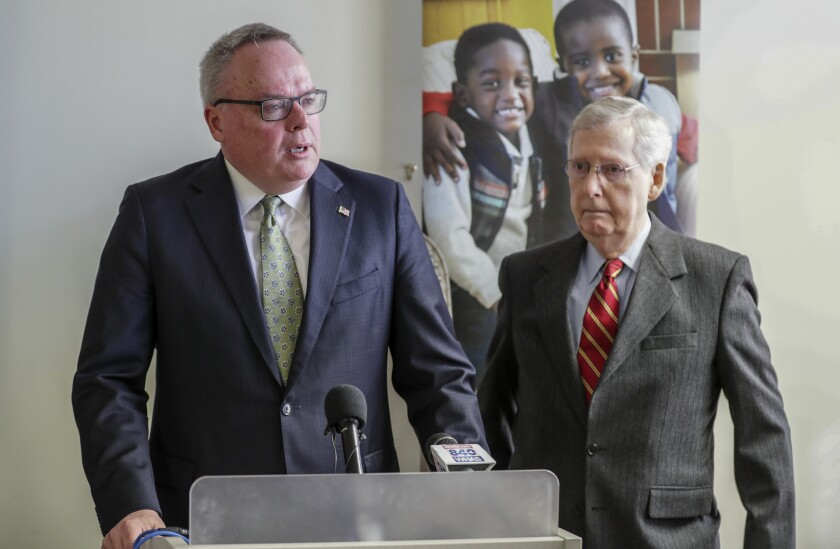 FILE - In this March 18, 2019 file photo, James Carroll, director of the Office of National Drug Control Policy, speaks at Volunteers of America as Senate Majority Leader Mitch McConnell looks on in Louisville, Ky. Drug overdose deaths surged by nearly 50% last year in Kentucky, where opioid addiction mixed with pandemic-related stress to set a new record for tragedy and grief from a crisis that continues to ravage the region, a new report said, Wednesday, Aug. 4, 2021.(Michael Clevenger/Courier Journal via AP, File)
