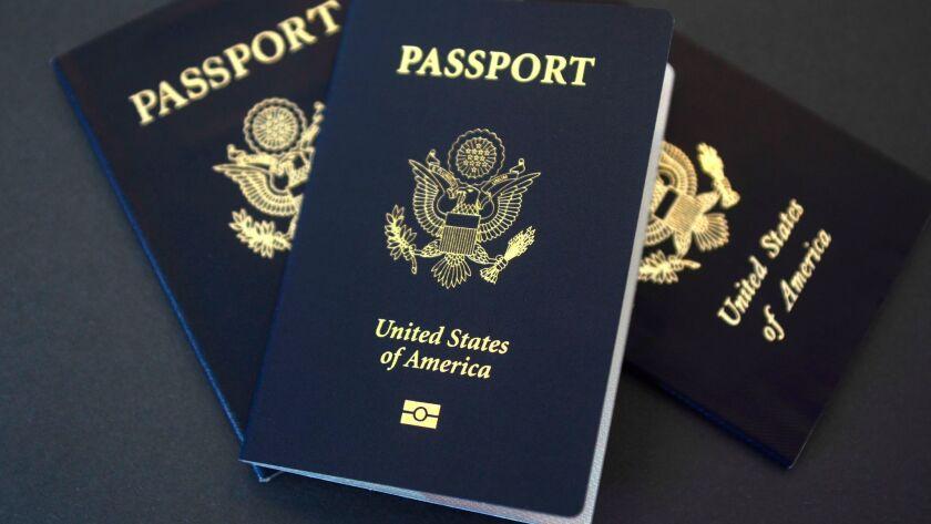 Three U.S. passports lie on a table