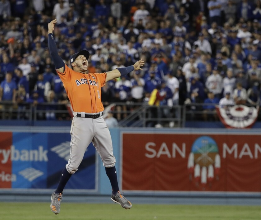 Houston Astros shortstop Carlos Correa celebrates after the Astros defeated the Los Angeles Dodgers to win the 2017 World Series.