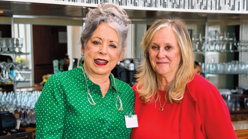 Event co-chairs Carolynn LaPierre and Roz Bradley attend the Village Garden Club of La Jolla's Holiday Luncheon, Dec. 12, 2019 at The Marine Room in La Jolla.