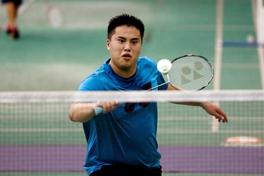 Phillip Chew practices at the Orange County Badminton Club on July 21.
