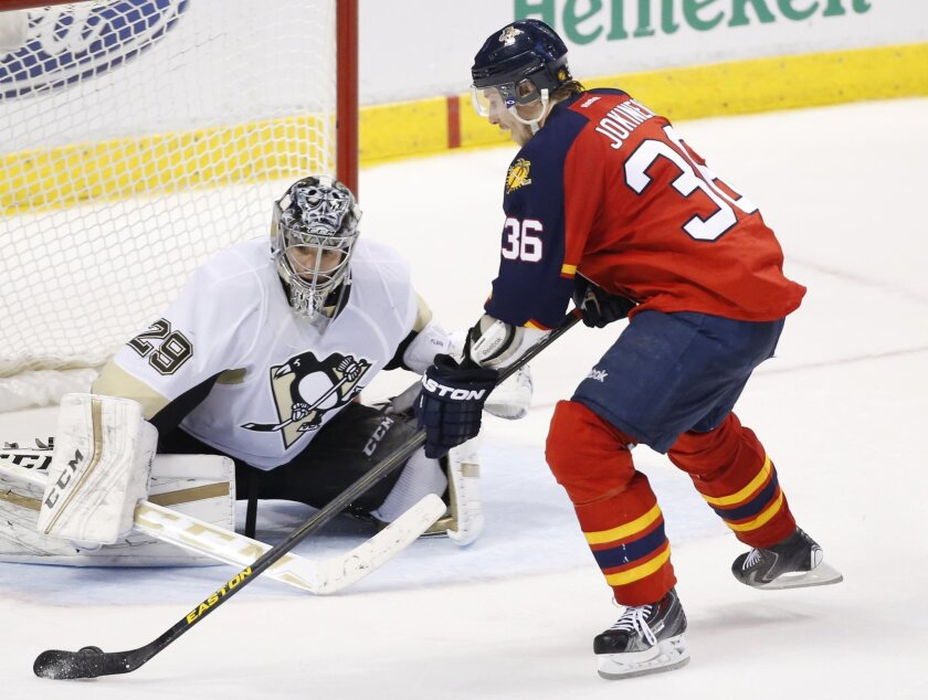 Florida Panthers left wing Jussi Jokinen (36) shoots the winning shot during a shootout against Pittsburgh Penguins goalie Marc-Andre Fleury (29) in an NHL hockey game, Monday, Feb. 15, 2016 in Sunrise, Fla. The Panthers defeated the Penguins 2-1. (AP Photo/Wilfredo Lee)