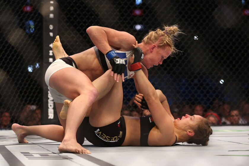 Holly Holm, top, upset Ronda Rousey at UFC 193 in Melbourne, Australia.