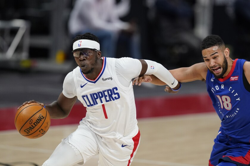 Clippers guard Reggie Jackson drives around Detroit Pistons guard Cory Joseph.