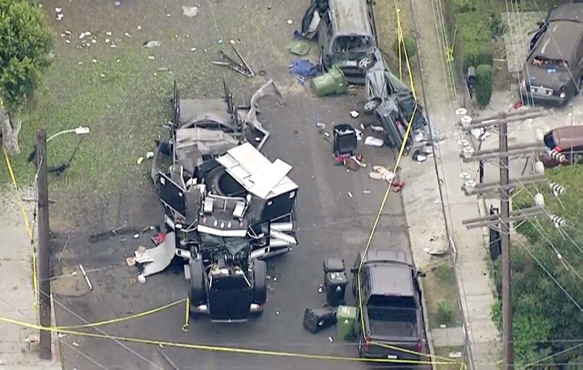 Aerial image shows remains of an armored LAPD tractor-trailer after fireworks exploded June 30.