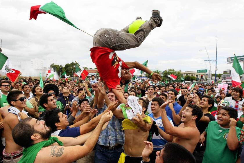 Mexicans celebrate in Guadalajara after the national team won the soccer gold medal in the 2012 London Olympic Games.