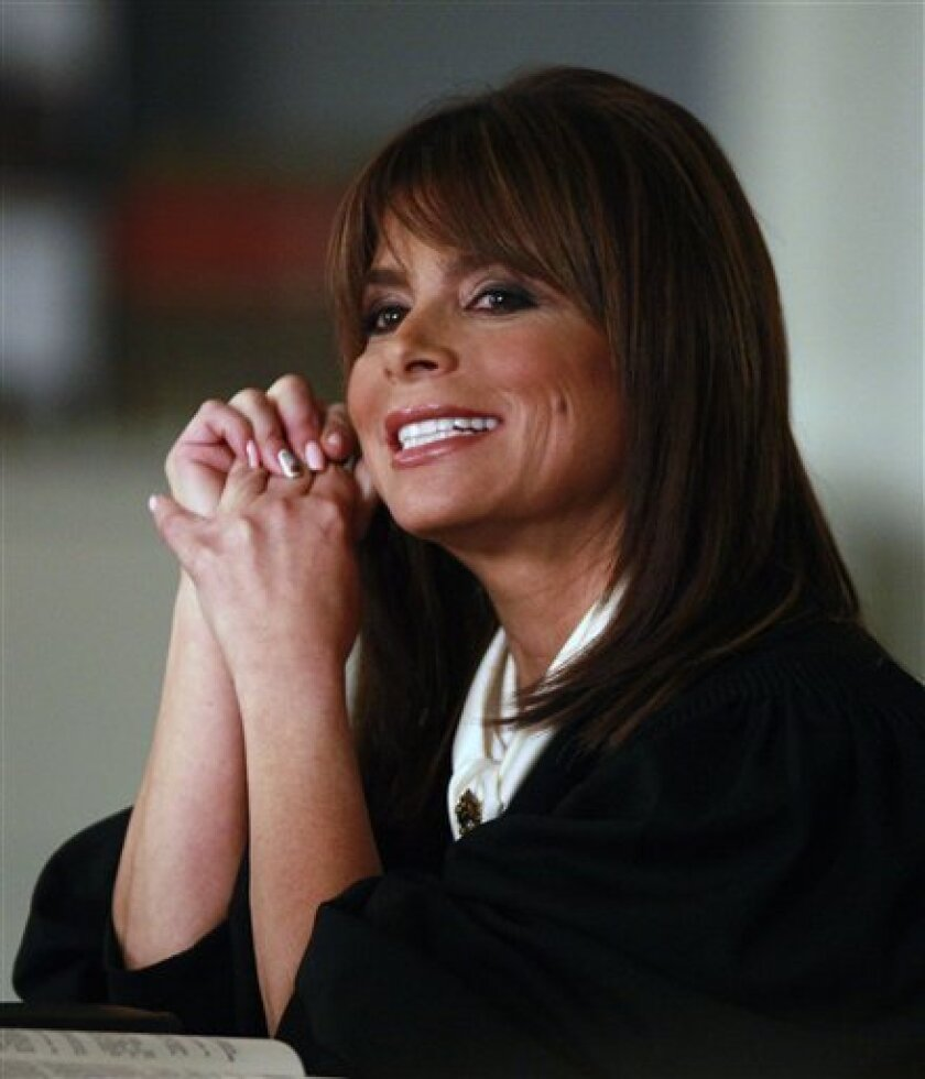 """Paula Abdul is shown during the taping of her show """"Drop Dead Diva"""" in a studio in Peachtree City, Ga., Monday, July 6, 2009. Abdul told the Associated Press that she is optimistic about returning for another season of """"American Idol."""" (AP Photo/John Bazemore)"""