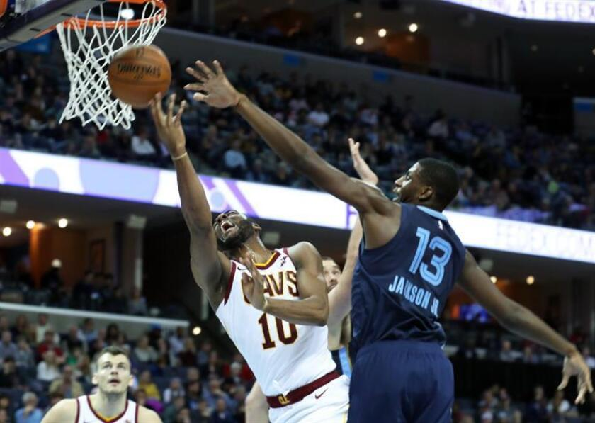 Memphis Grizzlies Jaren Jackson Jr. (R) guards against Cleveland Cavaliers Alec Burks (C) as he goes up for a basket during their NBA game at the FedEx Forum in Memphis, Tennessee, USA, Dec. 26, 2018. EFE-EPA/Karen Pulfer Focht
