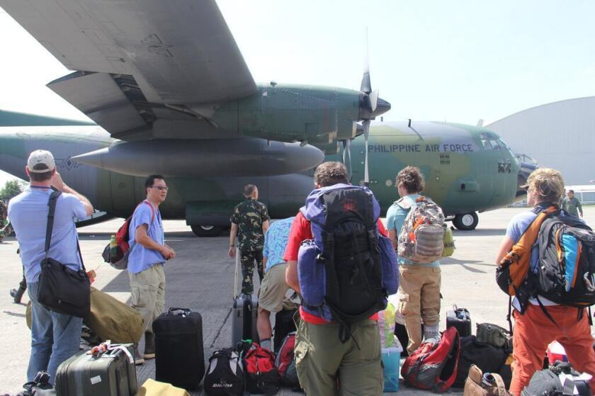A group of doctors from Mammoth Lakes boarding a Philippine Air Force C-130 cargo plane headed for Manila.