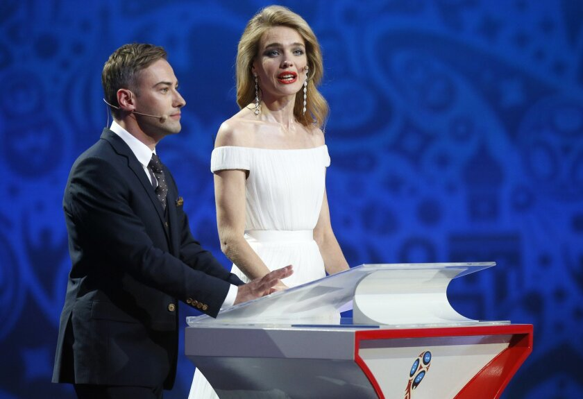 Russian model Natalia Vodianova, right, and Russia's TV presenter Dmitry Shepelev host the preliminary draw for the 2018 soccer World Cup in Konstantin Palace in St. Petersburg, Russia, Saturday, July 25, 2015. (AP Photo/Dmitry Lovetsky