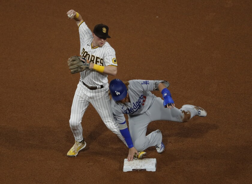 The Padres' Jake Cronenworth forces out Los Angeles Dodgers' Justin Turner