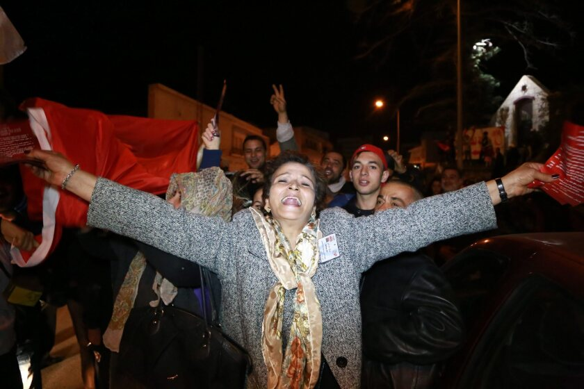 Supporters of Tunisian presidential candidate Beji Caid Essebsi celebrate the first results of the Tunisian elections in Sousse, Tunisia, on Dec. 21.