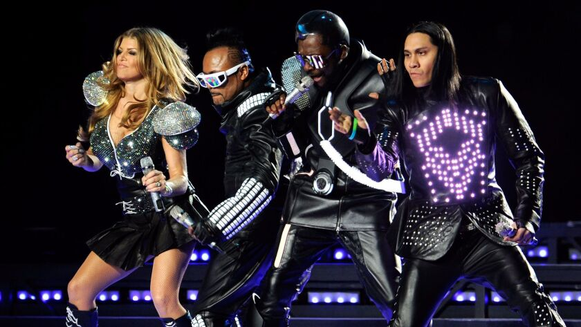 Fergie, apl.de.ap, will.i.am and Taboo of the Black Eyed Peas perform during the 2011 Super Bowl halftime show.