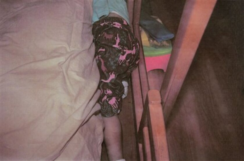 In this photo released by the Attorney Generals Office of the State of Mexico in Toluca, Mexico on Wednesday March 31, 2010, the lifeless body of Paulette Gebara Farah lies in between the matress and the bed frame in her bedroom on the outskirst of Mexico City. Authorities announced on Wednesday March 31, 2010 that the lifeless body of Paulette was found dead in her own bedroom, apparently asphyxiated and her mother is now a suspect.(AP Photo/Procuraduria General del Estado de Mexico)
