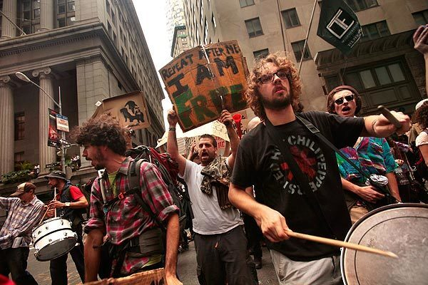 Occupy Wall Street began Day 13 with a march through the streets of Lower Manhattan around the time the opening bell rings at the stock exchange.