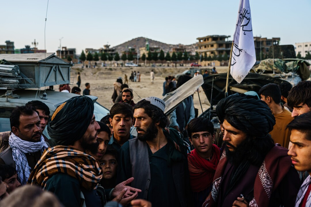 Taliban fighters gather in the outskirts of Kabul