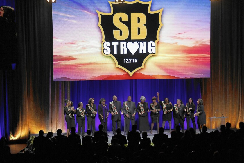 A choir sings during a private memorial service attended by San Bernardino County employees at Citizens Business Bank Arena in Ontario.