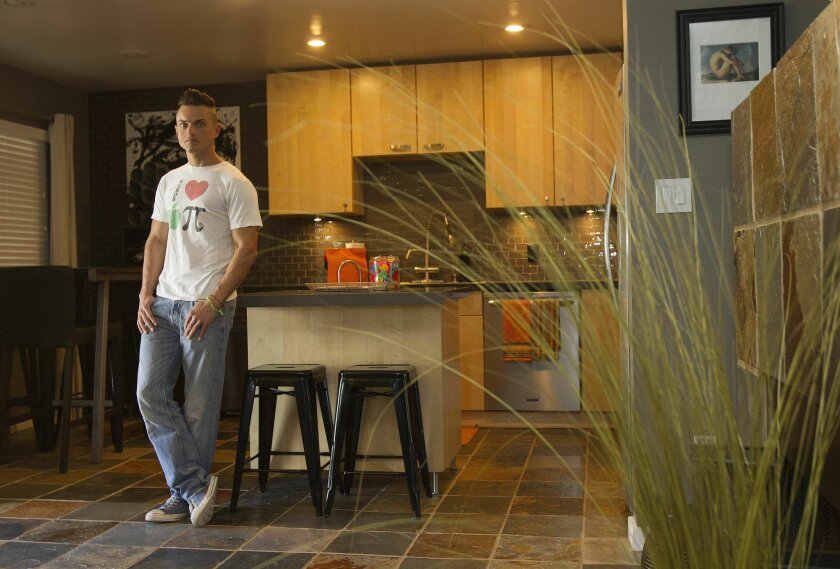 Isaiah Walter, who rents out a spare room in his North Park home, is one of thousands of homeowners in the county who are supplementing their incomes with revenue from short-term vacation rentals.