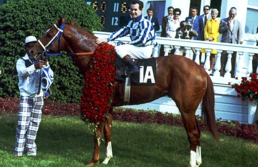 Jockey Ron Turcotte poses aboard Secretariatafter winning the Kentucky Derby in 1973.
