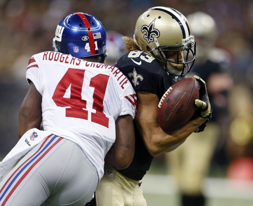 New Orleans Saints wide receiver Willie Snead (83) fumbles as he is hit by New York Giants cornerback Dominique Rodgers-Cromartie (41) in the second half of an NFL football game in New Orleans, Sunday, Nov. 1, 2015. The fumble resulted in a touchdown return for the Giants. (AP Photo/Butch Dill)