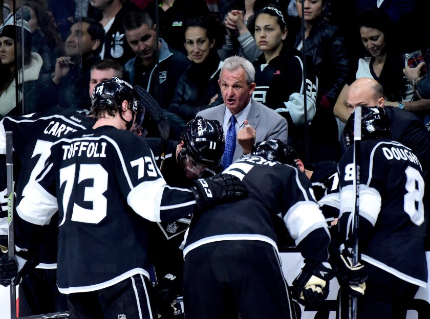 Coach Darryl Sutter talks to Kings players during a timeout in Game 1 of their playoff series against the Sharks last spring.