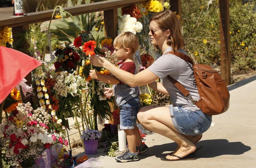 Britany Martin and son Theo, 2, at a memorial for boat fire victims in Santa Barbara Harbor
