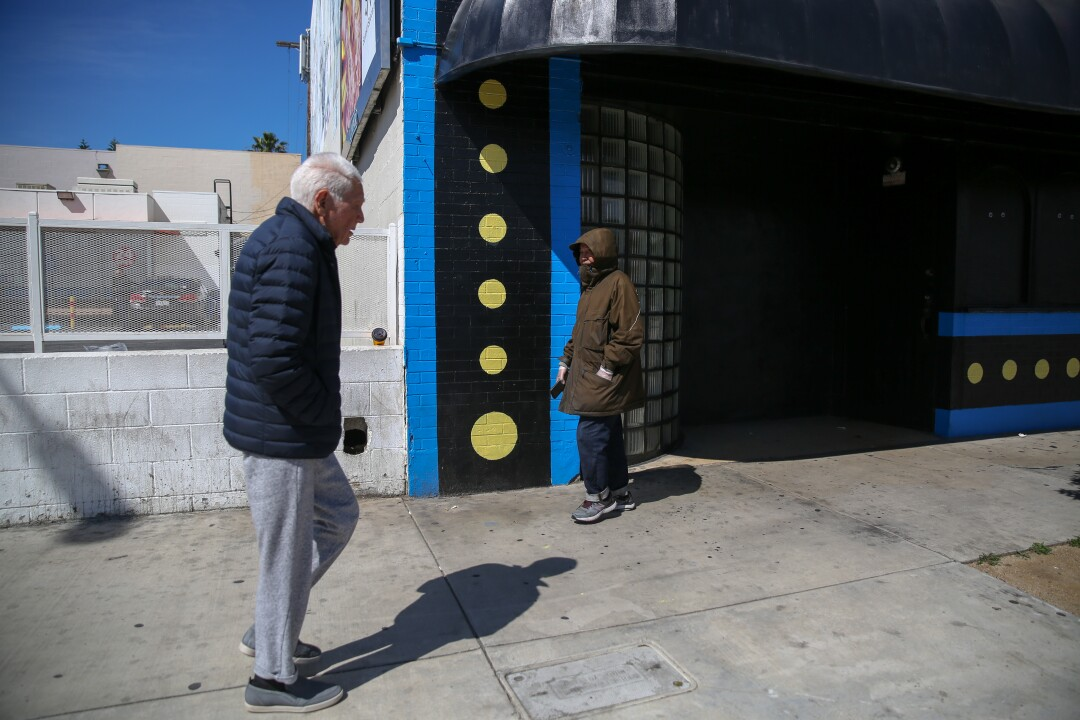 Ben Barcelona, right, on one of his daily walks through Koreatown, several days after Gov. Gavin Newsom ordered Californians to shelter at home.